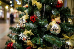 Adorned festive New Year tree. In store Stock Photo
