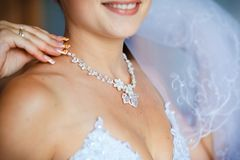 Adornment on neck of young bride Stock Image