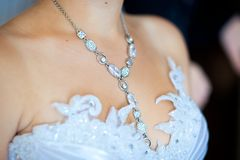 Adornment on neck of young bride Royalty Free Stock Photography