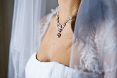 Adornment on neck of young bride Royalty Free Stock Images
