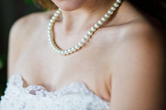 Adornment on neck of young bride Stock Photography