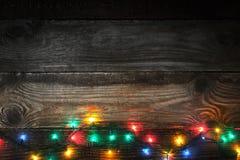Adorno colorido en el tablero de madera Imagen de archivo