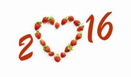 Adorno de la Navidad con las fresas en forma de corazón Imagenes de archivo