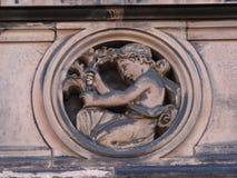 Adorno de piedra del niño en el edificio Imagen de archivo libre de regalías