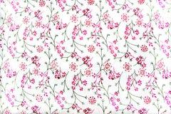 Adorno floral en la tela blanca Fotografía de archivo