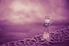 Adorno púrpura del ángel Imágenes de archivo libres de regalías
