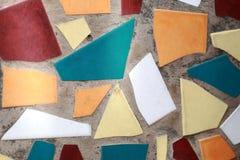 Adornos de la teja en el cemento del suelo Fotografía de archivo