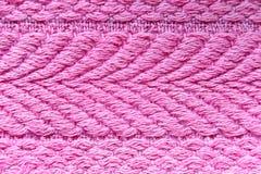Adornos de toallas rosadas en una macro Fotos de archivo