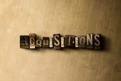 ADQUISICIONES - primer de la palabra compuesta tipo vintage sucio en el contexto del metal Fotografía de archivo libre de regalías