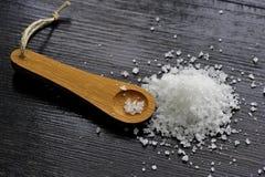 Adra sól na drewnianej łyżce Obrazy Stock