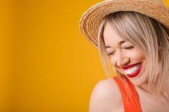 Adrable smiling confused embarrassed modest blonde woman in straw hat. Warm summer mood yellow background. Lovely happy. Emotions. Love is in the air stock photos