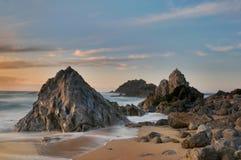 Adraga beach. Sunset at Adraga Beach in Sintra, Portugal Royalty Free Stock Images