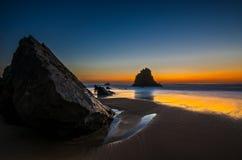 Adraga strandsolnedgång Fotografering för Bildbyråer