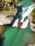Adrenalin Jet Boat Ride Canyon, New Zealand. Tourists enjoy a adrenalin jet boat ride on the Shotover River in Queenstown, New Zealand Royalty Free Stock Photos