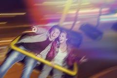 Adrenalin ride. Beautiful, young couple having fun at an amusement park Royalty Free Stock Photography