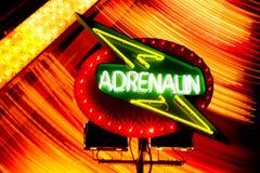 Adrenalin sign. At night at a thrill ride Stock Photos