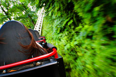 Adrenaline Rush. Photograph taken at high speed rushing through a  track at an amusement park. The track stretched through the woods at several areas where this Royalty Free Stock Photography