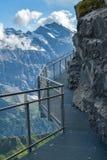 Adrenaline walking trail at the edge of steep cliff in Birg, near village of Murren. Switzerland royalty free stock image