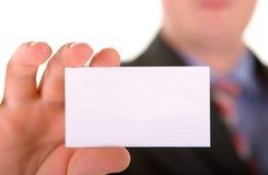 Adreskaartje in een hand Stock Afbeelding