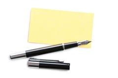 Adreskaartje en pen stock afbeelding