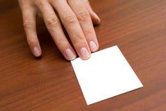 Adreskaartje op het bureau Stock Foto's