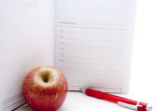 Adressbuch mit Apfel Stockfotos