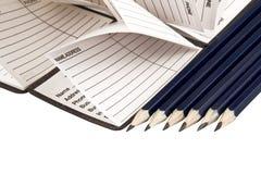 Adressbuch und Bleistifte Lizenzfreie Stockbilder