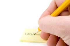 Adresse de Web d'écriture sur le papier photos stock