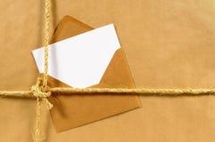 Adressen-Etikett oder Lieferungskarte, Pakethintergrund des braunen Papiers, Kopienraum Lizenzfreie Stockfotografie