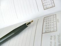 Adresses. Pen and adress book shallow dof stock photos