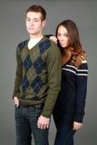 Adrette männliche und weibliche Mode-Modelle Lizenzfreie Stockfotografie