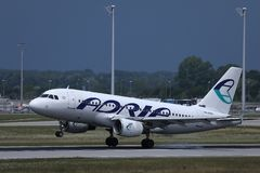 Adria Airways plane taking off. Adria Airways jet takes off from runway stock images