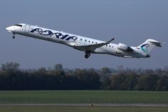 Adria Airways plane taking off. Adria Airways jet takes off from runway royalty free stock image