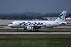 Adria Airways plane taxiing on runway. Adria Airways jet takes off from runway royalty free stock photography