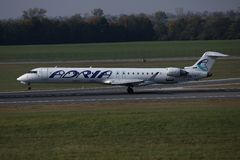 Adria Airways plane taxiing on runway. Adria Airways jet takes off from runway royalty free stock images