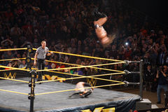 Adrian Neville flips in the air as he performs the red arrow as Stock Photo