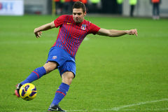 FC Steaua Bucharest- FC Gaz Metan Medias. Adrian Popa kicking the ball, during the football match, counting for the Romanian League One , between FC Steaua Royalty Free Stock Photo