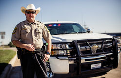 Adrian, Texas, USA. TEXAS, USA - AUGUST 5, 2013: Policeman in Texas on August 5, Adrian, USA Royalty Free Stock Images