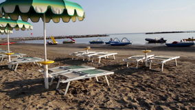 Adriatic beach umbrellas and sunbeds stock video