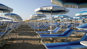 Adriatic beach umbrellas and sunbeds stock video footage