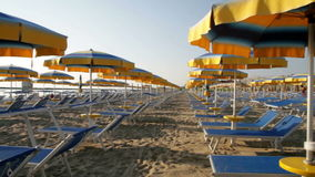 Adriatic beach umbrellas and sunbeds stock footage