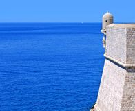 Adriatic blessings. Wall of Dubrovnik, Croatia, with statue in niche overlooking the Adriatic Sea stock image