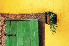Adriatic island green door on yellow wall Royalty Free Stock Photography