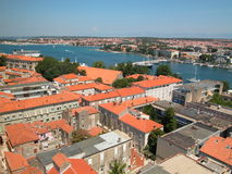 Adriatic scene, blue sea red roofs Royalty Free Stock Photography