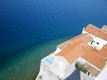 Adriatic sea. Red roof at the Adriatic sea background Royalty Free Stock Photo
