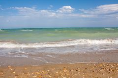 Adriatic Sea coast view. Seashore of Italy, summer sandy beach with clouds on horizon. Stock Image