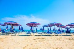 Adriatic Sea coast view. Seashore of Italy, summer umbrellas on sandy beach with clouds on horizon. Stock Photo