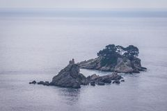 Adriatic Sea islets. Two small isles on Adriatic Sea - Sveta Nedelja and Katic near the shore of Petrovac, Montenegro Royalty Free Stock Image