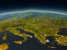 Adriatic sea region from space in the evening. Adriatic sea region in the evening from Earth's orbit in space. 3D illustration with detailed planet surface and Stock Image