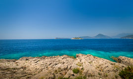 Adriatic sea rocky coast and old fortress ruins on a small island stock photos